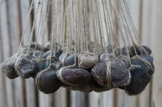 suspended stones by colchu, via Flickr