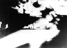 Heavy cruiser USS Quincy illuminated by Japanese searchlights during Battle of Savo Island, 9 Aug 1942 (public domain via Database) Singapore Island, Singapore Travel, Ireland Beach, Heavy Cruiser, Vacation Places, Vacation Travel, World War Ii, Wwii, Tourism