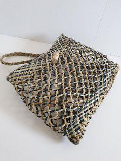 Description: Accessories > Backpack Handmade harakeke kete whakairo (Maori) / flax weaving backpack by ANISOR. Color: Natural/Blue Measurement: Width Height Material: Harakeke,Muka (Maori) / New Zealand flax Made in NEW ZEALAND Flax Weaving, Weaving Art, Basket Weaving, Woven Baskets, Abstract Sculpture, Wood Sculpture, Bronze Sculpture, New Zealand Flax, Cultural Crafts