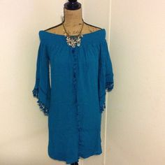 """Blue Off Shoulder Dress This is a super cute dress or tunic by Exhilaration! Tassels down front and on sleeves. Size medium. Loose fitting and come. Cute with boots or booties. NWT. 100% Rayon. Lining 100% polyester. Length is apprx 34.5"""" Exhilaration Dresses Midi"""