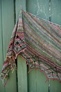 "Poppy Seed is an easy top down crescent shaped shawl with a large stocking stitch section and shallow lace border, designed to highlight the beauty of variegated handspun yarn, which is otherwise lost in more complicated stitch patterns. Knit in Ashford's delicious Merino/Silk ""Poppy Seed"" sliver, the resulting shawl is a delightfully rustic little beauty. *When substituting yarns choose a tonal or variegated laceweight yarn. I recommend Woollen Rabbit's Chantilly Lace. In this relatively…"