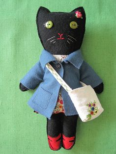 Florence Kitty in Liberty dress, wool felt coat and vintage messenger bag