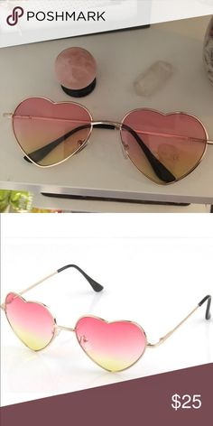 Pink and yellow ombré heart shaped sunnies Wicked cool heart shaped pair of sunnies with a pink and yellow ombré mirrored lenses! Gold metal framing.Brand new with 400% uv protection Accessories Sunglasses