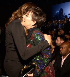 Hugging it out: Caitlyn embraced the matriarch while Corey relaxed in the audience...