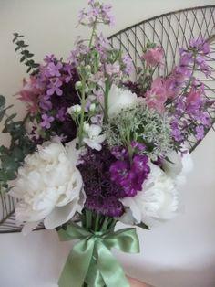 Fragrant arrangement of peonies, sweet rocket and stocks