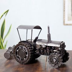 Detailed with precision, this sculpture is made from metal pieces once used in cars, buses and even in construction. Armando Ramirez crafts this original sculpture with a car's rocker arm, breaker points and chains, as well as chain bearings from a bus.