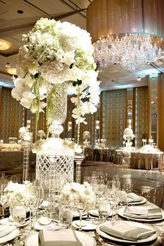Gorgeous #centerpieces at this #white #uplighting #wedding #reception ! #diy #unique #weddingideas #weddinginspiration #ideas #inspiration #rentmywedding #celebration #party By #KehoeDesigns