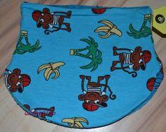 Gut dehnbare Halssocke für Kopfumfang44-48in Hellblau mit Palmen und Äffchen.Sieist aus weichem Baumwolljersey gearbeitet. Das Futter besteht ausblaue