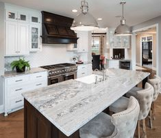 A beautiful granite countertop with hints of blue and brown make it a perfect match for a traditional or farmhouse white kitchen. The hints of brown are pulled with the dark stained range wood hood. White Granite Countertops, Kitchen Remodel, Kitchen Design, Farmhouse Kitchen Countertops, Kitchen Countertops, Kitchen Marble, Granite Kitchen, Countertops, Leather Granite