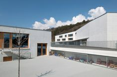 Built by Frei Rezakhanlou Architects in Chermignon, Switzerland with date 2010. Images by Thomas Jantscher. The facilities are used by five distinct villages and propose a kindergarten, a primary school and a multi-purpose ha...