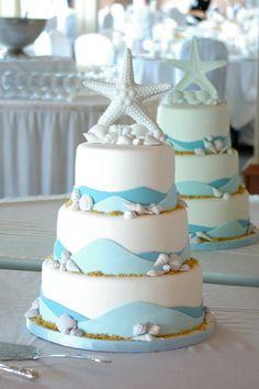 I love the wave idea of this beach wedding cake