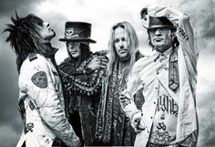 Motley Crue they look at me every morning lol have this on my wall