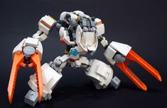 Who knew LEGO brick separators could be so handy? Kevin Low turned his extra brick separators into claws for this swift-looking mecha. The flashy orange claws stand out as the key features of this creation, and the subtle use of orange pieces elsewhere ties the whole model together. Related