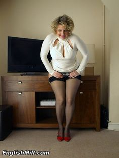 English MILF Daniella in black stockings and heels