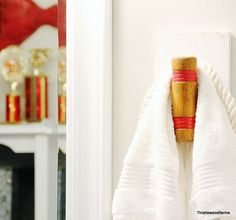 Hook for a bathroom made from an old croquet mallet! Love this!