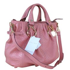 Céline Pink Sling Tote Leather Bags originally priced at $1222.78 now $308.74. Again, not totally my style, but the color's cute.