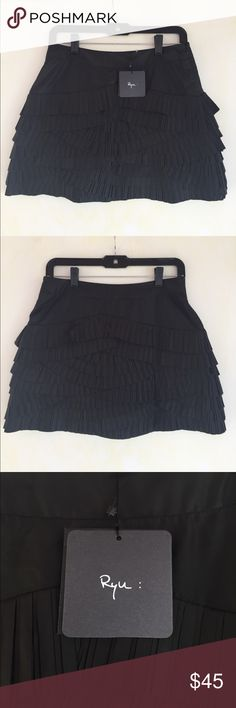 NWT RYU Black Pleated Skirt, S This sassy RYU Black Pleated Skirt, S would look great in the cloud or on the dance floor! Pair with heels  BRAND NEW, NO DEFECTS AND COMES FROM A SMOKE FREE HOME. Ryu Skirts Mini