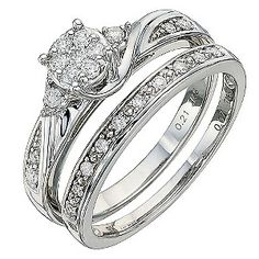 £799.00Stunning 9ct white gold bridal set featuring cluster and twist design engagement ring with diamond shoulder detailing and diamond set wedding band totaling 0.28 carat diamonds.
