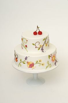 Finish cake with confectionary cherries (can be made out of marzipan, sugar paste or Satin Ice Fondant).