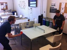 Connor vs Matt, mini ping-pong in the kitchen. (That glass surface is murder.)