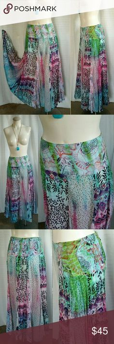 """Boho Maxi Flared Skirt - Large $95 on ebay, $45 here! :-) Sacred Threads Boho Maxi Gypsy Skirt - Tie Dye & Patchwork with Smocked waist in back. Metallic thread wrapped ends of string ties from waist drawstring - with blue beads & miniature jingly bells, 3 on each tie. 100% Cotton. Half slip lining. Size Large. Waist 32"""" flat with stretch to 38"""" max. 42"""" hips, measured at the lining layer. Length 36"""".  Perfect condition from nonsmoking home. Sacred Threads Skirts Maxi"""