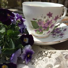 """You never have too many violets! Enjoy your tea in this lovely English bone china cup and saucer, """"with a side of violets, please""""!"""