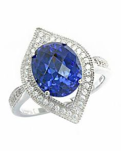 Our 9.12 CTW Tanzanite White Gold Rhodium / Sterling Silver Ring makes a standout addition to your collection.