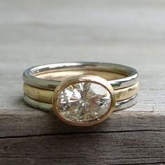This gorgeous sparkler features a fiery Forever One G-H-I moissanite x equivalent to a carat diamond) set in a handmade bezel on a round band with a hand textured finish. All of the metal used in the construction of this ring is yellow gold from recycled Cute Engagement Rings, Alternative Engagement Rings, Diamond Engagement Rings, Moissanite Rings, Dainty Ring, Thing 1, Fine Jewelry, Men's Jewelry, Jewelry Making