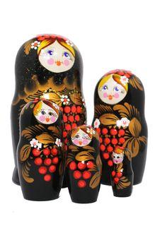 Russian matryoshka set with 5 nesting dolls and rowan berries decoration