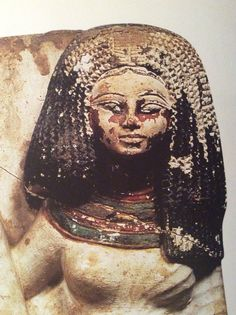 19th dynasty lady with wavy braids. Each set of two wavy strands have their…