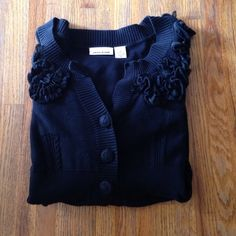 """DKNY Cardigan Black knit cardigan sweater by DKNY Jeans. Three buttons. Knit flowers around collar. Great condition. Aprox measurements laying flat Bust 17"""" Length 24""""  ✅Offers Welcomed Trade DKNY Sweaters Cardigans"""