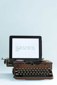 A typewriter that works with both iPad and with paper. Seriously so awesome