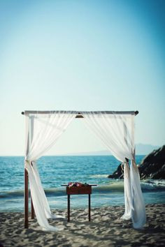 style me pretty - real wedding - mexico - puerto vallarta wedding - dreams vallarta - ceremony decor - bamboo chuppah