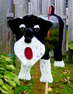 Schnauzer mailbox - Handcrafted and hand painted animal mailboxes by artist Michel Devost in Quebec. If you would like to order a special mailbox, contact Michel at http://pages.globetrotter.net/miche/mailboxes.html