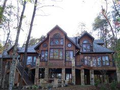 wood & stone house with black trim