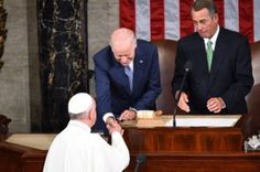 US Vice President Joe Biden (C) and US House Speaker John Boehner (R) greet Pope Francis as he arrives to address a joint session of Congress on September 24, 2014 in Washington, DC. The Pope is the first leader of the Roman Catholic Church to address a joint meeting of Congress, including more than 500 lawmakers, Supreme Court justices and top administration officials including Vice President Joe Biden.    AFP PHOTO/JIM WATSON        (Photo credit should read JIM WATSON/AFP/Getty Images)