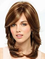 Kelly Wig by Amore. Multiple layers combine forces to create this evocative design. This wig features a Hand-tied Top with double Monofilament construction for maximum comfort and styling flexibility along with a chameleon-like base layer, which has the ability to match your own individual scalp color.