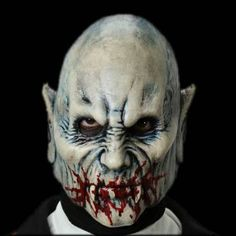 Two piece vampire mask with separate jaw piece that allows for mouth movement. Prepainted with straps that hold it in place. Ancient and wise, this vampire is to be feared. With a fully movable jaw an