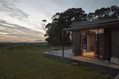 Pergolas and canopies softern larger metal clad forms. Fish Creek House - a Small, Off-the-Grid Holiday Home by ArchiBlox Dulux Natural White, Rustic Color Schemes, Melbourne, Off Grid House, Outdoor Baths, Fish Creek, Shed Homes, Wood Patio, Architect House