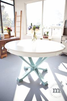 This beautiful pedestal table has been van Gogh painted with a 'river tide' base and a 'morning mist' table top. Wouldn't this look beautiful in a sunny room?