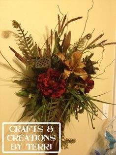 Sconce floral arrangement. These can be done in any color and/or any holiday.  Please visit www.Etsy.com/shop/CreatedByTerri  or www.facebook.com/CraftsandCreationsByTerri for updates and contest giveaways!!!