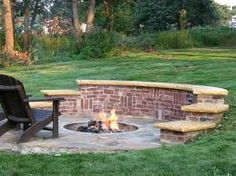 Building a Round Brick Fire Pit I like the steps and back wall could put potted plants there