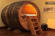This was a 19th-century beer barrel.  Now, it's a bed.