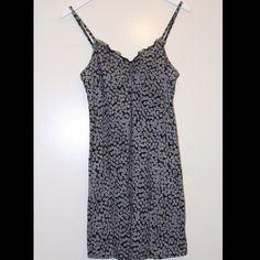 Black and white spaghetti strap tank dress Black and white spaghetti strap tank dress with built in bra. Size medium. In great condition. Dresses