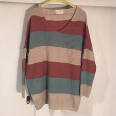 Oversized striped sweater Cute with Leggings. Excellent condition. No size, but best for a medium Prince and Princess Sweaters V-Necks