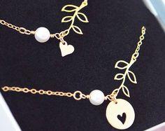 Gouden armband van moeder dochter ingesteld hart blad