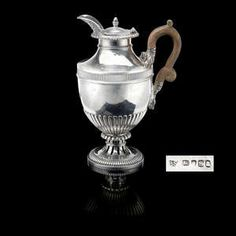 LOT:37 | A George III silver hot water pot by Paul Storr.