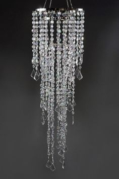 """Quality crystal chandeliers and crystal decorations at wholesale prices.    Multi Diamond Cut Chandelier 3 Tier 34"""" $50 each / 2 for $48 each     Measures 10"""" diameter x 33.5"""" long. 3 tiers. Large acrylic crystal beaded chandelier with light socket and plug.    Top tier is 10"""" wide x 13.5"""" long  Middle tier 6-3/4"""" wide x 18-1/2"""" long   Bottom tier is 4"""" wide x 26"""" long."""