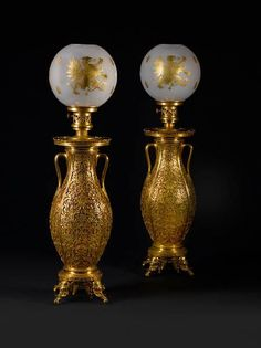 *An important pair of French late 19th century gilt bronze persan-style amphora-lamps. Designed by Edouard Lièvre, executed by Ferdinand Barbedienne