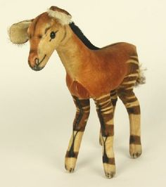 """11"""" stuffed velvet Okapi, with nylon mane, featuring black glass eyes and airbrushed features, West Germany, 1958-68, by Steiff."""
